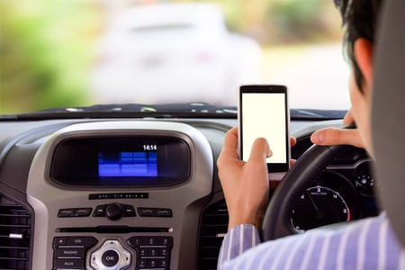 If there are degrees of danger, driving while reaching for your cell phone